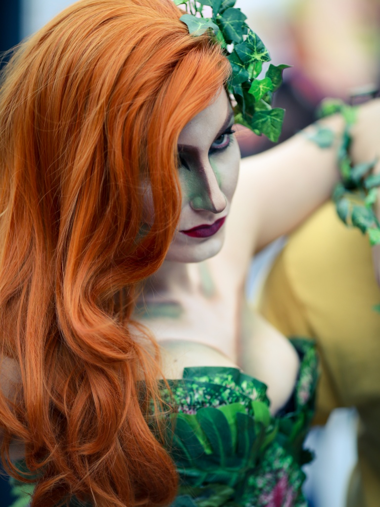 A cosplay artist doing Poison Ivy cosplay, a famous comic character. Comic Con New York, October 2014.