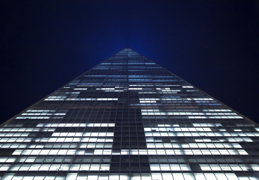 The view of the new One World Trade Center tower up into the night skies of New York. October 2014.